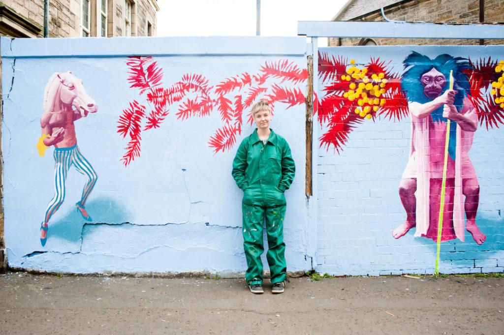 Kat Gollock in front of Dalmeny Street mural