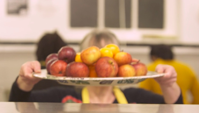 Fay adding apples to the display, Eve's Pudding was a symbol of temptation, image http://rarebirdmedia.com/