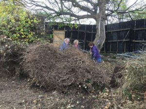 Volunteers clear through scrub growth by the hidden gate to Granton Castle walled garden