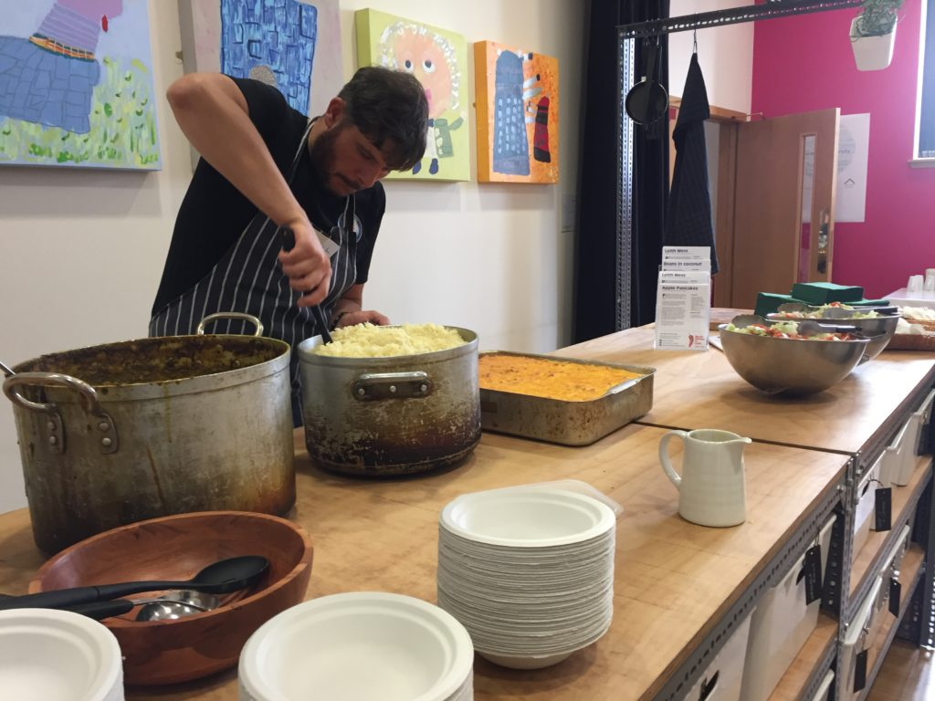 Brendan Lamont of Leith Depot digging into huge pots of chickpea curry and macaroni cheese
