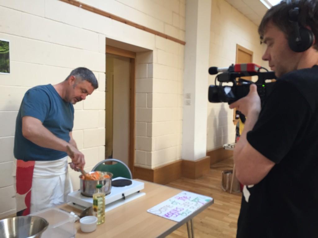Gavin coaxes carrots into a pan while Dougal films