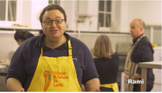 Rami in World Kitchen in Leith apron remembering how he broke the pork taboo: image credit http://rarebirdmedia.com/