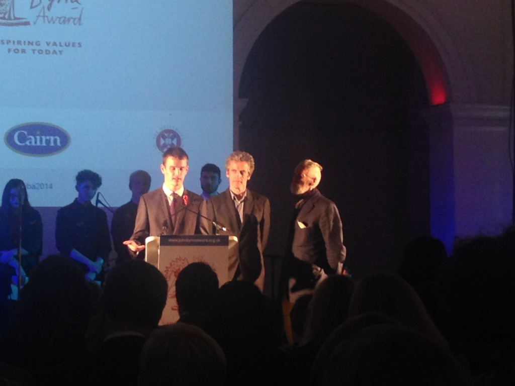 Andrew MacDonald on stage with Peter Capaldi