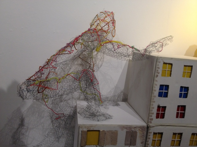 Wire frame sculpture, ascending staircase built of houses