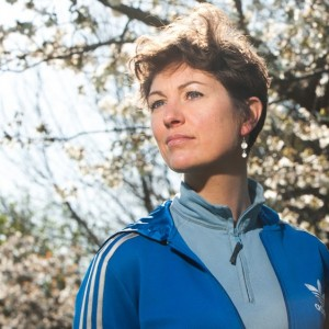 Tracy in blue tracksuit by a cherry blossom tree