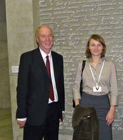 Ola and Malcolm standing in the Scottish Parliament lobby.